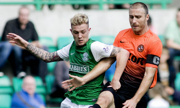 Sean Dillon challenges  Danny Handling during Saturday's match at Easter Road.