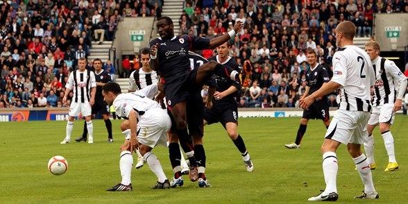 John Stevenson, Courier,21/08/10.Fife.Kirkcaldy,Starks Park,Raith Rovers v Dunfermline Athletic.Pics show match action as Raiths Gregory Tade goes up for a ball.