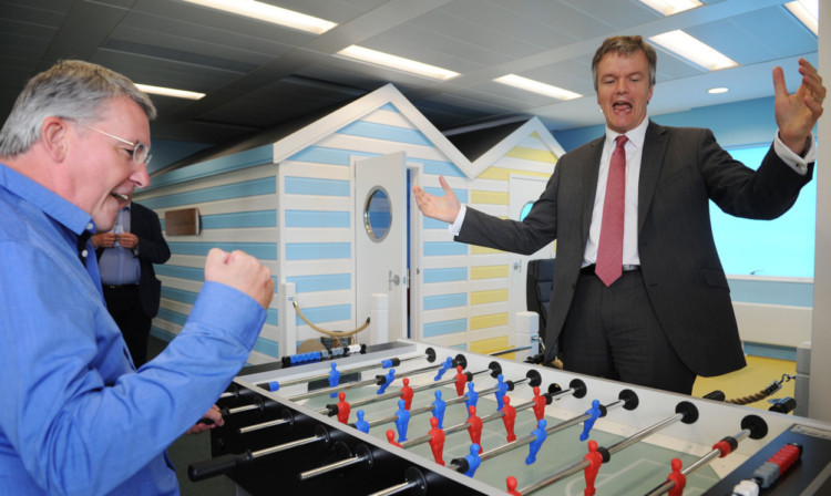 Mr Moore concedes defeat in a round of table football with YoYo Games chief executive Sandy Duncan.