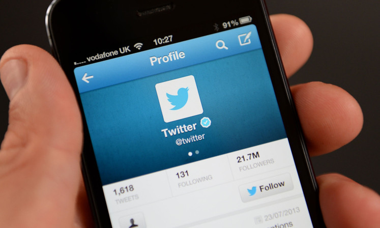 General view of the Twitter application in use on an iPhone 5