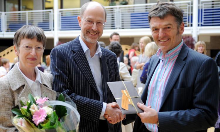 Morag and Paul Ballard with Dr Joe Walker, NHS Tayside director of public health.