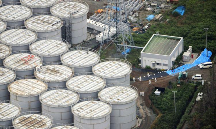 Workers checking storage tanks at the Fukushima Dai-ichi nuclear plant.