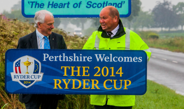 Mr Miller and Charles Haggart, Perth & Kinross Council roads service manager, with one of the Ryder Cup signs.