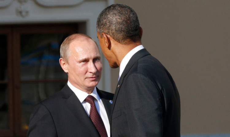 US President Barack Obama speaks with Russian President Vladimir Putin at the start of the G20 summit in St Petersburg.