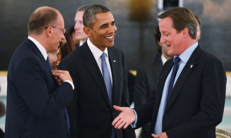From left; Italian Prime Minister Enrico Letta, U.S. President Barack Obama and British Prime Minister David Cameron talk.