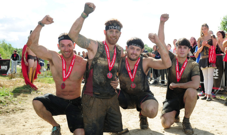 Lance Bombardier James Simpson celebrates with his friends (left to right) Tom Storey, James Simpson, Phil Midwinter and Jonny Sedman.
