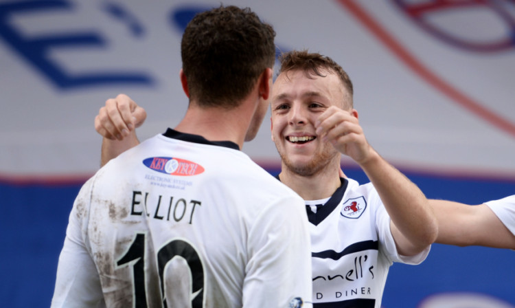 Greig Spence (right) celebrates his goal with team mate Calum Elliot after giving Raith the lead in the quarter-final against Falkirk.