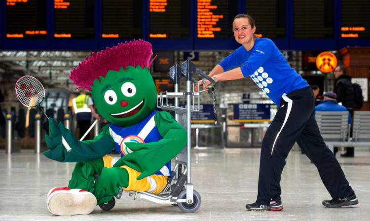 Scottish badminton star Susan Egelstaff joins 2014 games mascot Clyde at Central Station in Glasgow.