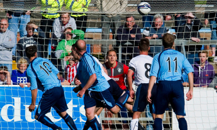 Gavin Swankie, left, scores the winner in the League Cup tie against Rangers last month.