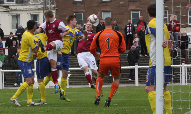 A goalmouth scramble during Saturday's seven-goal thriller.