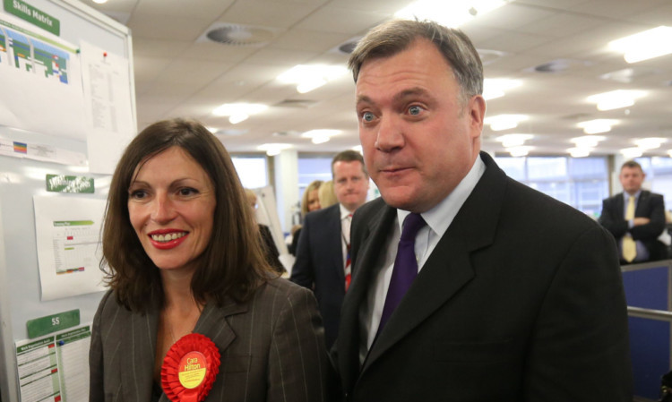 Shadow chancellor Ed Balls with Labour candidate Cara Hilton during their visit to Lloyds Banking Group in Dunfermline.