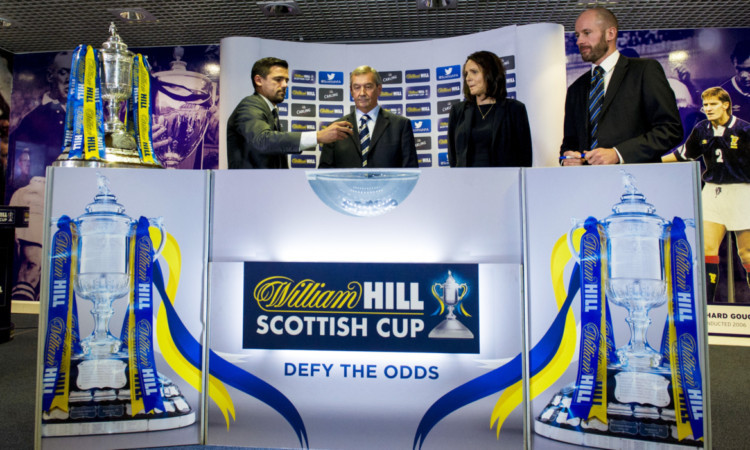 Nacho Novo (left) joins SFA President Campbell Ogilvie for the draw.