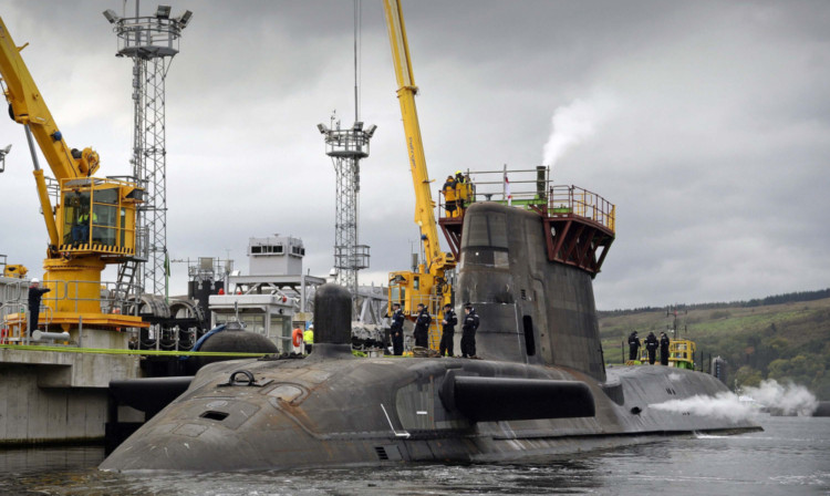HMS Astute at sea and HMS Ambush berthing alongside Valiant Jetty for the first time.
