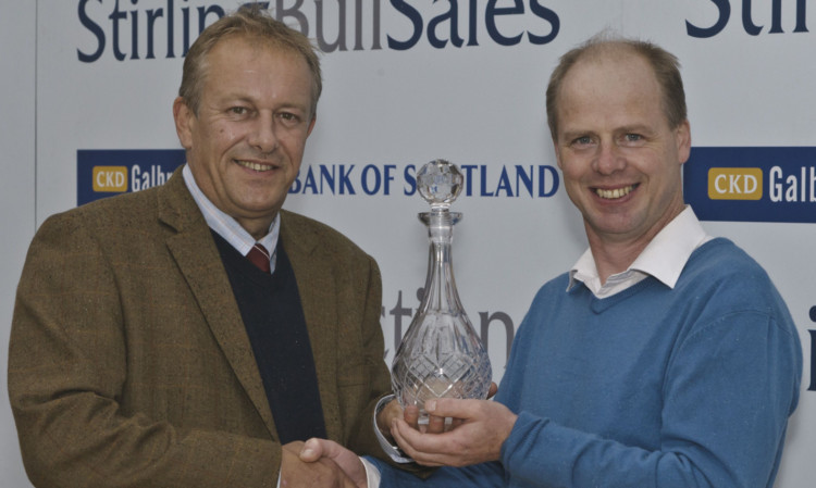 Mark Holmes, president of the Beef Shorthorn Society (left) presents Raymond Martyn with his decanter as winner of the Morrisons Beef Shorthorn suckler herd of the year award