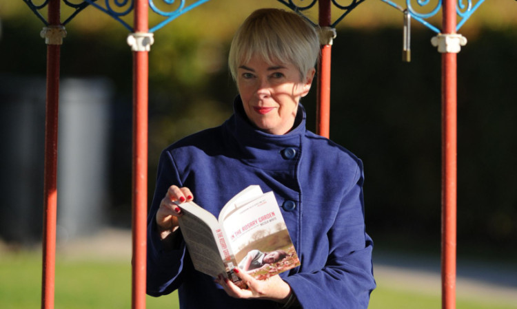 Nicola White and the book which won her the Dundee International Book Prize.