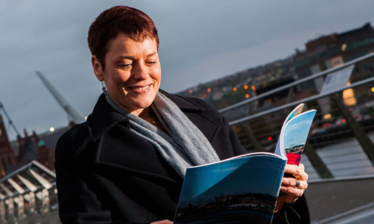 Dundee team member Janet Archer with the city's bid document after last week's presentation in Derry-Londonderry.