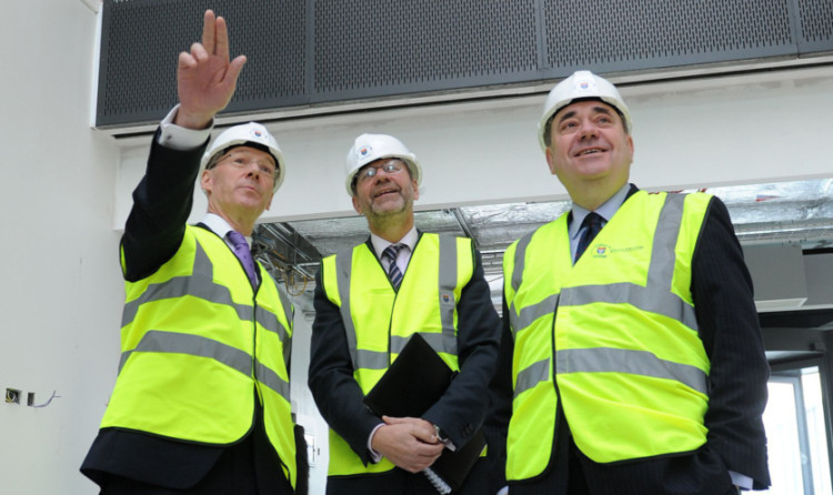 John Swinney, Dundee University principal Professor Pete Downes and Alex Salmond in the James Black Building being constructed at the university.