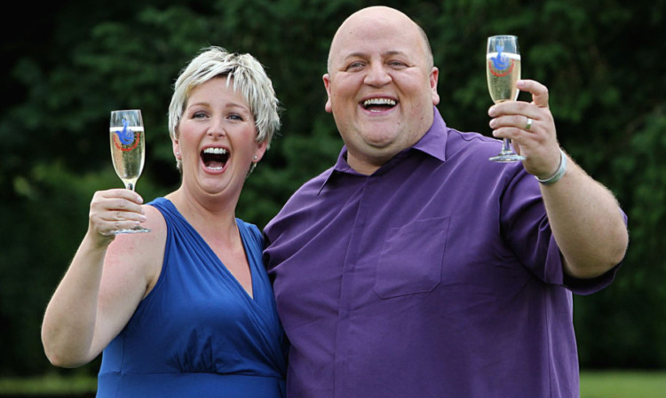 Gillian and Adrian Bayford celebrating their huge win last August.