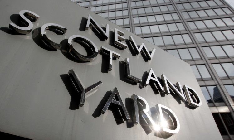 """File photo dated 9/4/2009 of New Scotland Yard, the headquarters of the Metropolitan Police, in Westminster, London. The names of 42 dead children were used by undercover officers to create fake identities but their families have not been told because of the risk to police, a report said today. PRESS ASSOCIATION Photo. Issue date: Tuesday July 16, 2013. Derbyshire Chief Constable Mick Creedon, who is leading a probe into the activities of police moles, said that, while the relatives deserve an apology, revealing the names used """"would and could put undercover officers at risk"""". See PA story POLICE Undercover. Photo credit should read: Dominic Lipinski/PA Wire"""