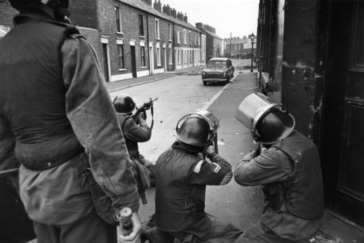 British soldiers take aim at civil rights demonstrators in the Falls Road, Belfast, on July 10 1970.
