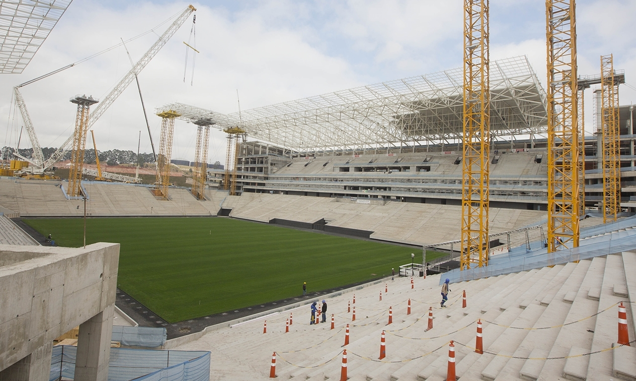 FILE - In this Aug. 19, 2013 file photo, a view of the ongoing construction at the Itaquerao Stadium also known as Arena Corinthians, in Sao Paulo, Brazil. Part of the stadium that will host the World Cup opener in Brazil next year collapsed Wednesday, Nov. 27, 2013, causing significant damage and killing three people, authorities said. (AP Photo/Andre Penner, File)