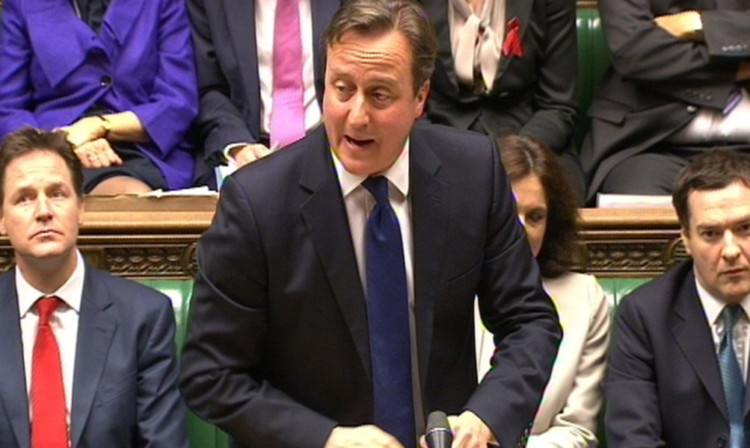 Prime Minister David Cameron speaks during Prime Ministers Questions in the House of Commons.
