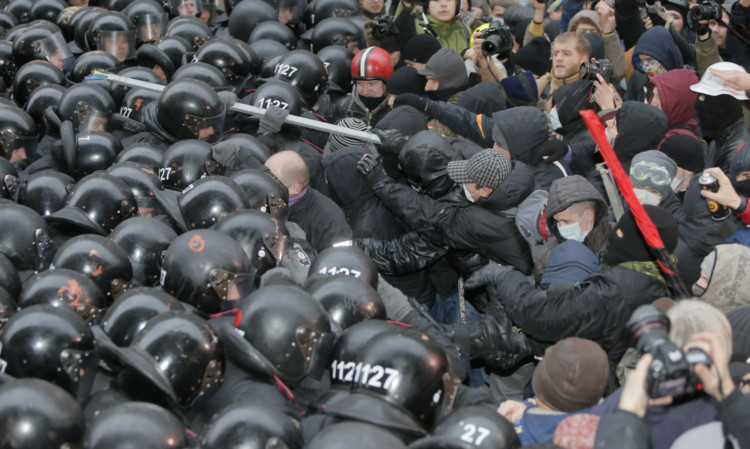 Protesters clash with police at the presidential office in Kiev, Ukraine.