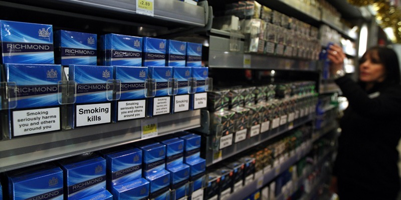 Steve MacDougall, Courier, Cooperative, High Street, Auchterarder. Picture of cigarette gantry to illustrate success of trading standard initiative against underage sales.