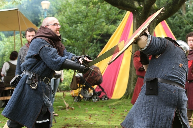 DOUGIE NICOLSON, COURIER, 27/08/11, NEWS. Pictured at Pittencrieff Park today, Saturday 27th August 2011, at the Bruce Festival, some members of the Clanranald Trust of Scotland, give a weapons demonstration.