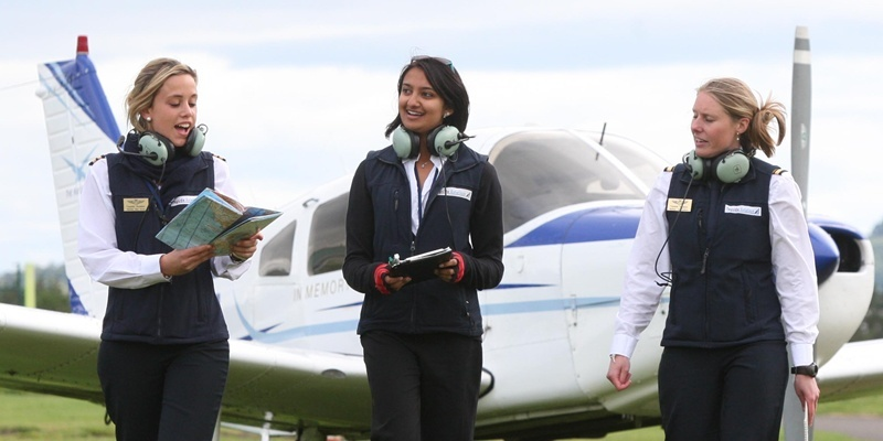 Steve MacDougall, Courier, Tayside Aviation, Dundee Airport, Riverside, Dundee. National Women in the Air Day. Pictured, left to right are flight instructors Montse Mas Arcos, Neema Soni and Melissa van Geldrer, beside the 'Evie Saunders' plane.