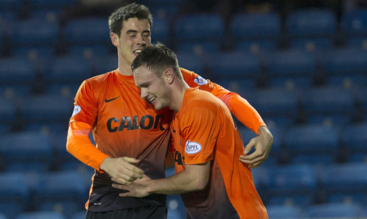 Keith Watson is congratulated by Brian Graham after opening the scoring.