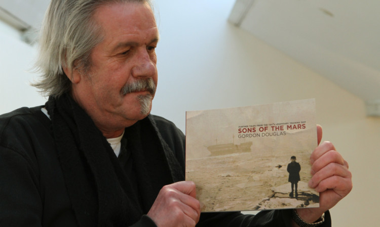 Gordon Douglas with a copy of his new book, Sons of the Mars.