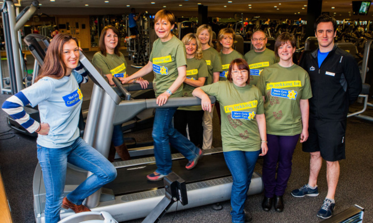 Petra McMillan, far left, with fundraisers including Susan Cleghorn on the treadmill and personal trainer Paul Carberry, far right, who will work with the group to raise their fitness levels.