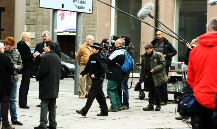 Filming scenes in West Marketgait.