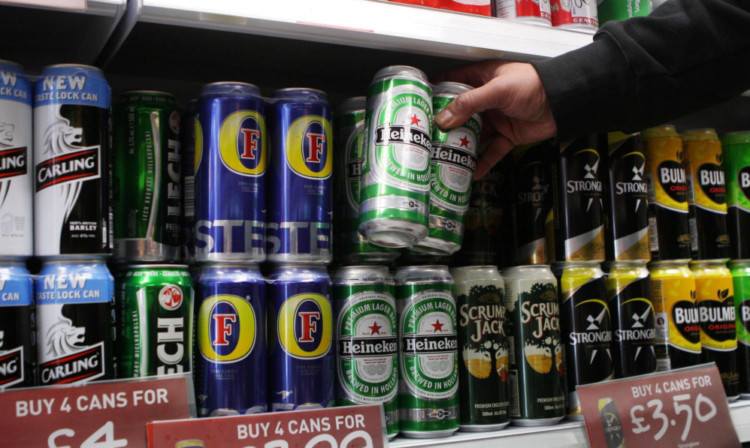File photo dated 02/09/2010 of cans of lager and cider on the shelves in an off-licence. The Government will not go ahead with proposals for a minimum unit price for alcohol, Home Office Minister Jeremy Browne told MPs. PRESS ASSOCIATION Photo. Issue date: Wednesday July 17, 2013. See PA story HEALTH Alcohol. Photo credit should read: David Cheskin/PA Wire