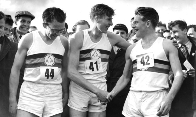 Chris Chataway, right, congratulates Roger Bannister on becoming the first man to break the four-minute mile barrier in 1954. On the left is Chris Brasher, who died in 2003.