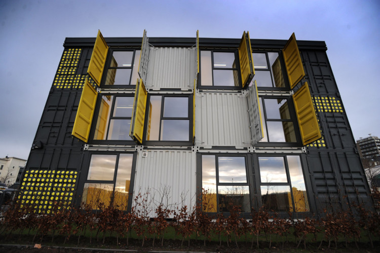Scores of employees in Dundees creative sector could be set to find out what its like to work in a shipping container following the official opening of the first unit in the citys new District 10 business district. The bright, airy and flexible office space has been created from 37 steel containers at a former rail yard in the Seabraes area of the city. It is expected to support 60 jobs across 15 companies  but with eight more blocks on the drawing board, total economic benefits could run to some £10m a year by the time the project is complete.