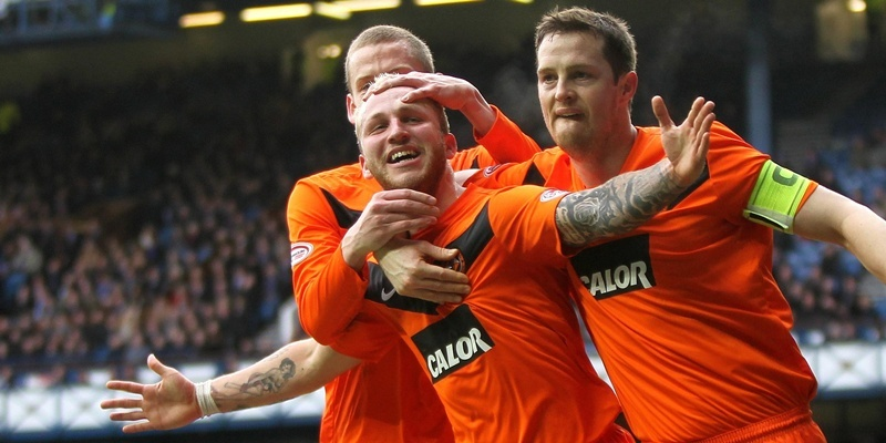 Dundee United's Johnny Russell (left) celebrates scoring his sides second goal with Jon Daly (right) during the Scottish Cup Fifth Round match at Ibrox Stadium, Glasgow.