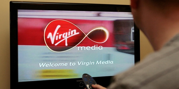 Undated file photo of a man looking at a Virgin Media welcome screen on a television. The cable operator is to create 620 new jobs as it looks to meet demand for its broadband and television on-demand service.