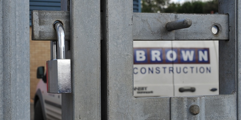 Kim Cessford - 20.08.12 - pictured is the yard of Brown Construction, Ainslie Street, West Pitkerro Industrial Estate where staff gathered to get news of their fate - locked gates after the meeting