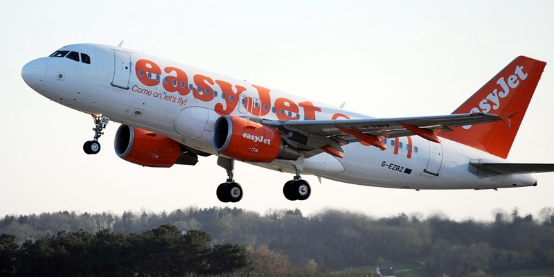 File photo dated 21/04/10 of a plane of the budget airline easyJet, as the low-cost airline posted smaller winter losses as the benefit of benign weather offset a further jump in fuel costs.