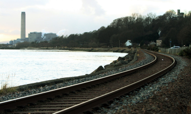 The railway line next to the Forth at Culross, with Longannet Power Station in the distance.