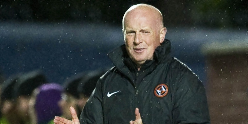 25/09/12 SCOTTISH COMMUNITIES LEAGUE CUP 3RD RND QOTS v DUNDEE UTD (0-1) PALMERSTON PARK - DUMFRIES Dundee Utd manager Peter Houston stands on the touchline.