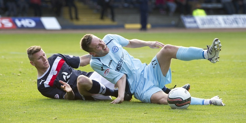 Dundee v St Johnstone....29.09.12      SPLSteven MacLean goes down under a challenge by Iain Davidson and suffers either a broken arm or a dislocationPicture by Graeme Hart.Copyright Perthshire Picture AgencyTel: 01738 623350  Mobile: 07990 594431
