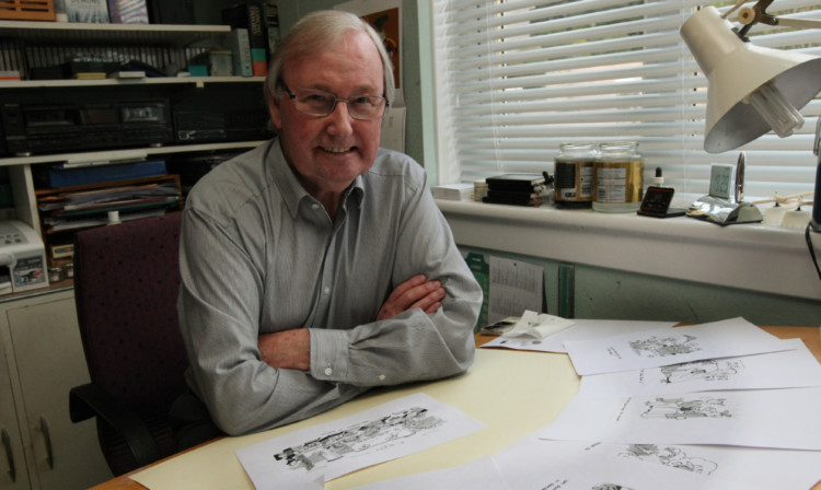 Mr Bell at his drawing table.