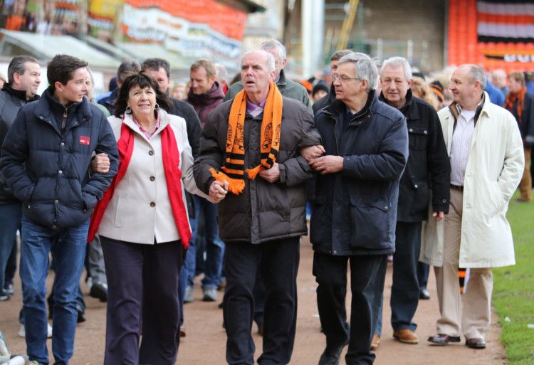 Dundee United legends joined fans and the family and friends of Frank Kopel for a fundraising walk around Tannadice on Sunday. Former players including Hamish McAlpine, Dave Narey, Paul Hegarty, John Holt, John Reilly and Dave Bowman were among those who completed a sponsored walk around the ground to raise funds for the Frank Kopel Alzheimers Awareness Campaign. Frank and his wife Amanda  who has led the campaign fighting for more support for families affected by Alzheimers  were at the front of the procession, which was also attended by Dundee FC heroes Bobby Glennie and Les Bar.