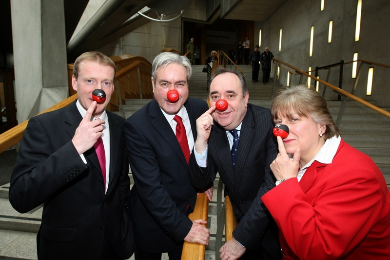 Steve MacDougall, Courier, Bottom of Lobby Stairs, Scottish Parliament, Edinburgh. Picture of four Scottish party leaders sporting Red Noses. Pictured, left to right is Tavish Scott (Lib Dem), Iain Gray (Labour), Alex Salmond (SNP) and Annabel Goldie (Conservative).