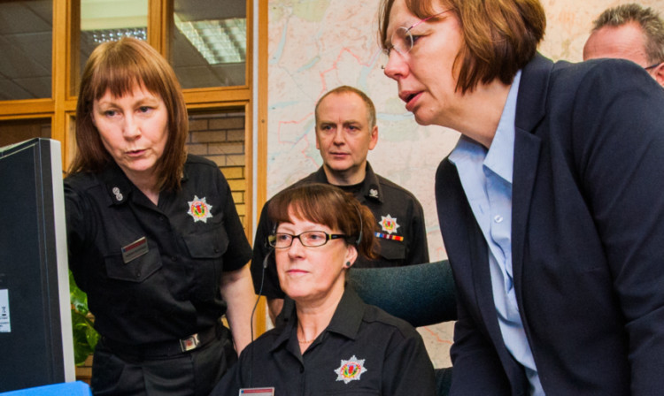 Staff at the fire control room in Dundee meeting MSP Alison McInnes on a previous visit.