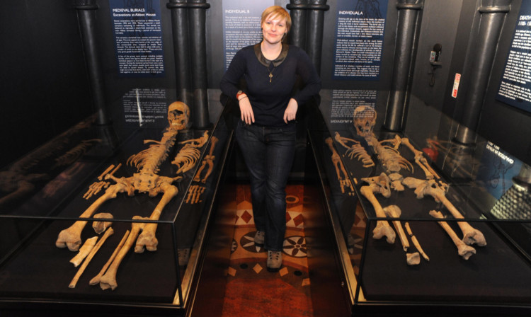 Gillian Ramsay beside the skeletons which form part of the new exhibition.