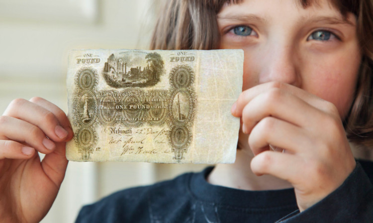 A replica of the 150-year-old one pound note.